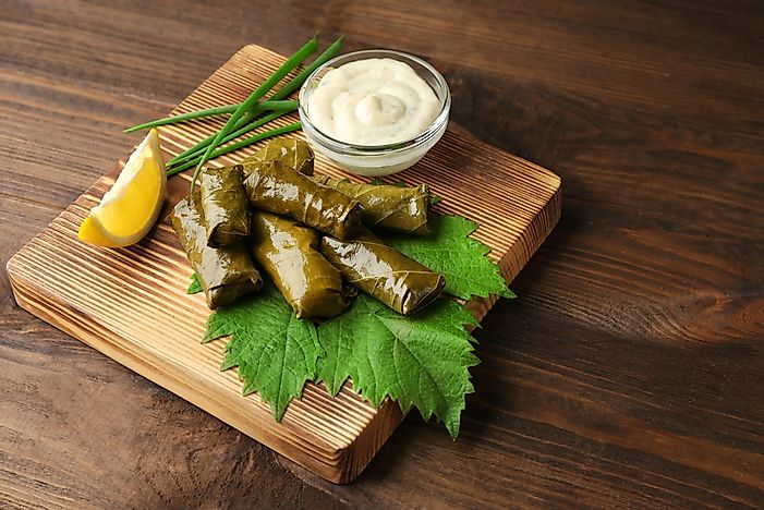 Stuffed dolma with lemon sauce.