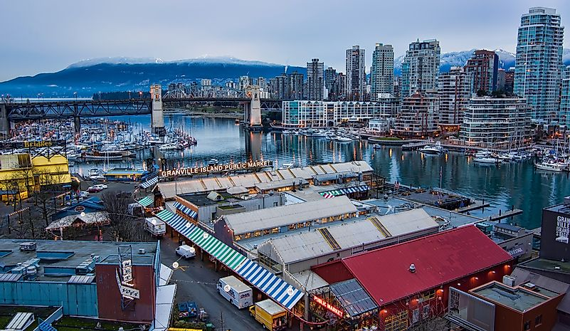 The booths of Granville Island with Vancouver in the background.