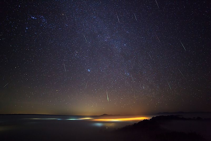 Geminid Meteor in the night sky and fog at Khao Takhian Ngo View Point at Khao-kho Phetchabun,Thailand.