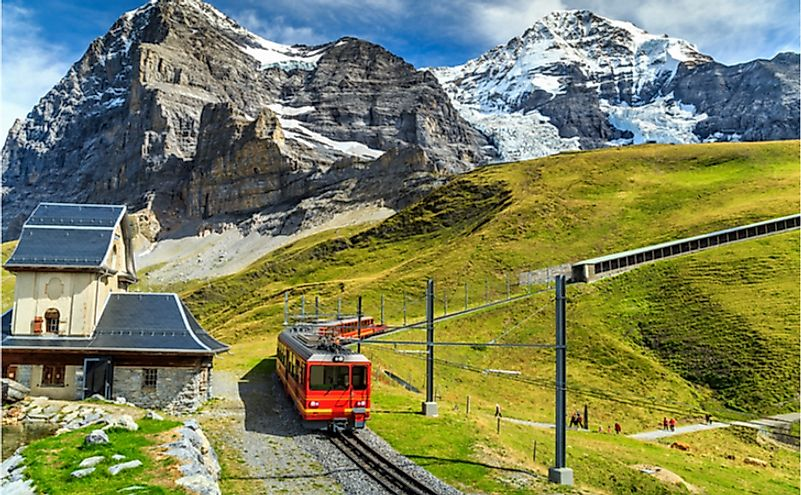 Famous electric red tourist train coming down from the Jungfraujoch station.