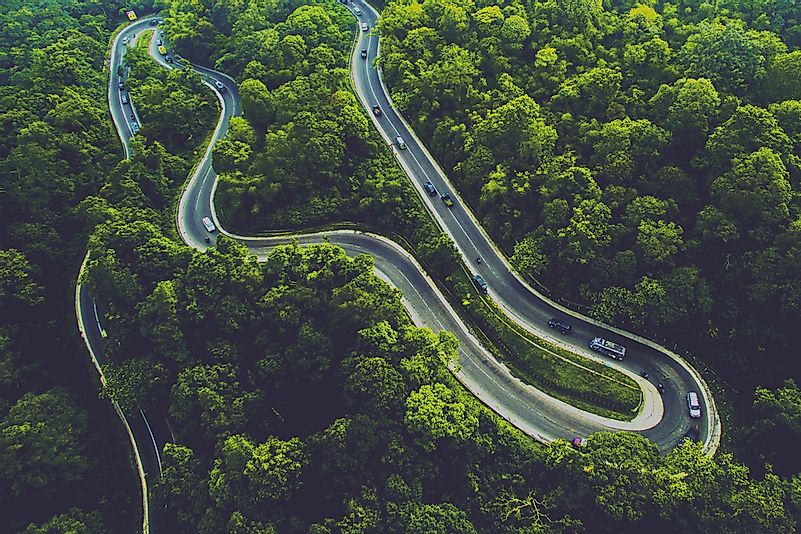 Winding road through Sumatra's luscious tropical forest.
