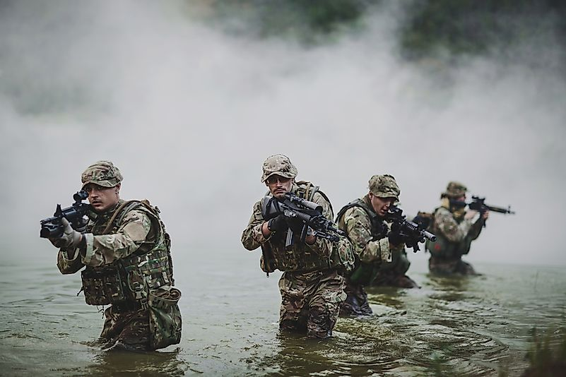 British special forces soldiers with weapon take part in military maneuver.