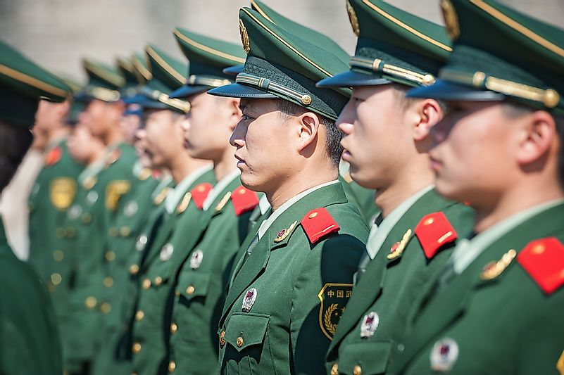 Chinese soldiers attend a parade at Tiananmen square on November 8, 2012 in Beijing, China