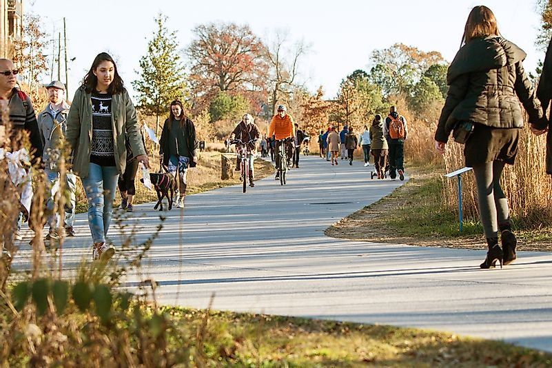 Editorial credit: BluIz60 / Shutterstock.com. People walk along the Beltline recreational area in Old Fourth Ward, Atlanta.