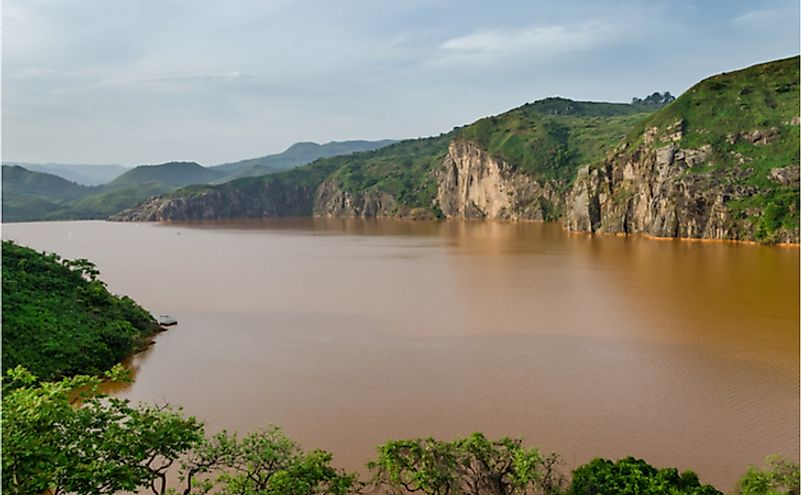 The calm brown water of Lake Nyos, infamous for CO2 eruption with many deaths.