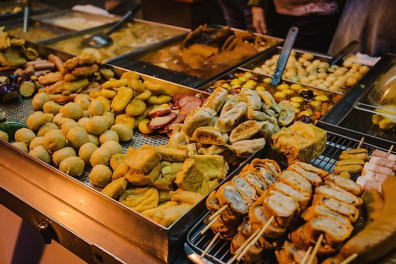Street food offerings in a Hong Kong night market.