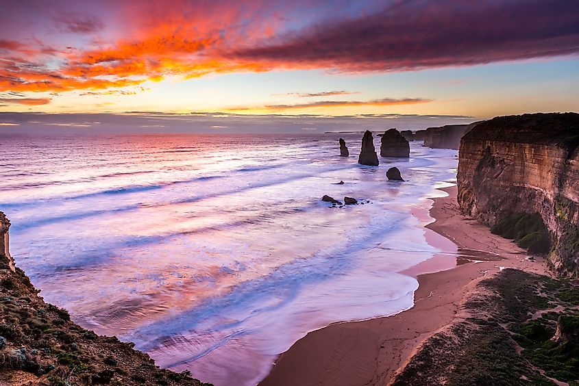 The sun sets over the Twelves Apostles on the Great Ocean Road, Australia. Image credit: James Whitlock/Shutterstock.com