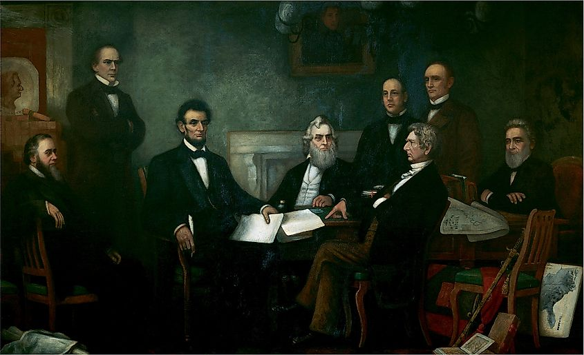 Lincoln meets with his cabinet at the First Reading of the Emancipation Proclamation, a presidential declaration that freed 3 million enslaved people.