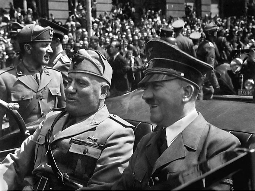 Hitler and Mussolini in a car together in the 1940s.