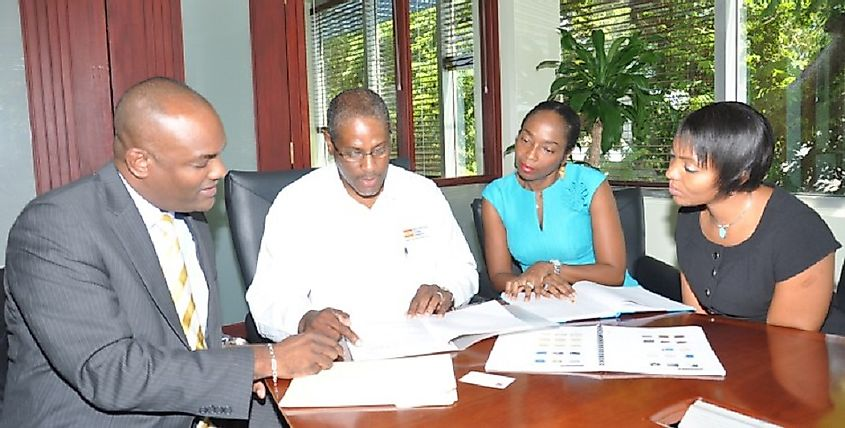 Business owners in Barbados meet with a bank's lending office to secure investment financing.