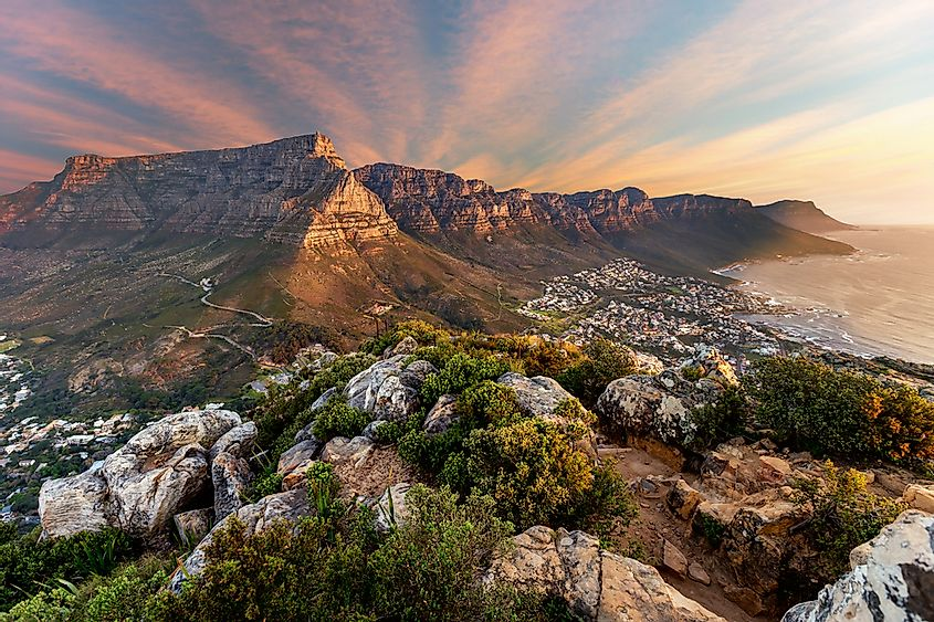 A sunset over Table Mountain, a mountain near Cape Town, South Africa, in the region of southern Africa.