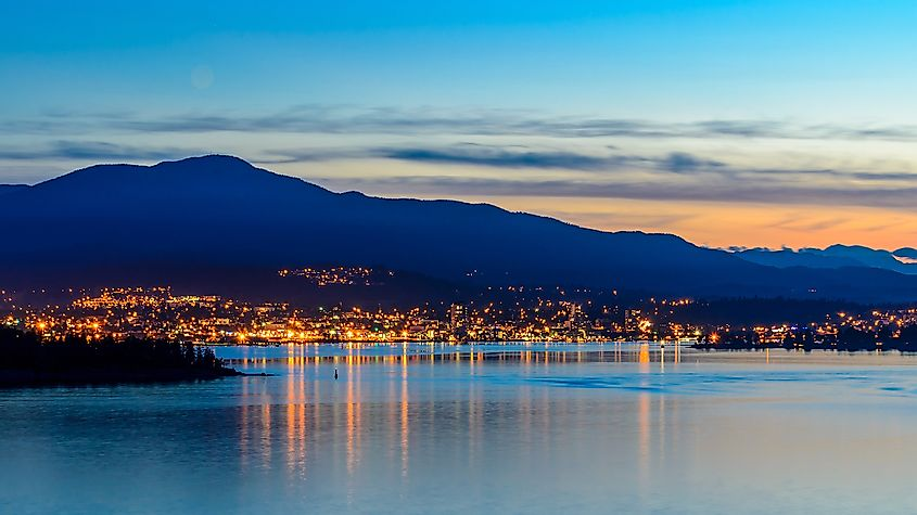 Tranquil sunset and evening illuminations of the beautiful town of Nanaimo on Pacific Ocean in Vancouver, Canada. Image credit: karamysh/Shutterstock.com