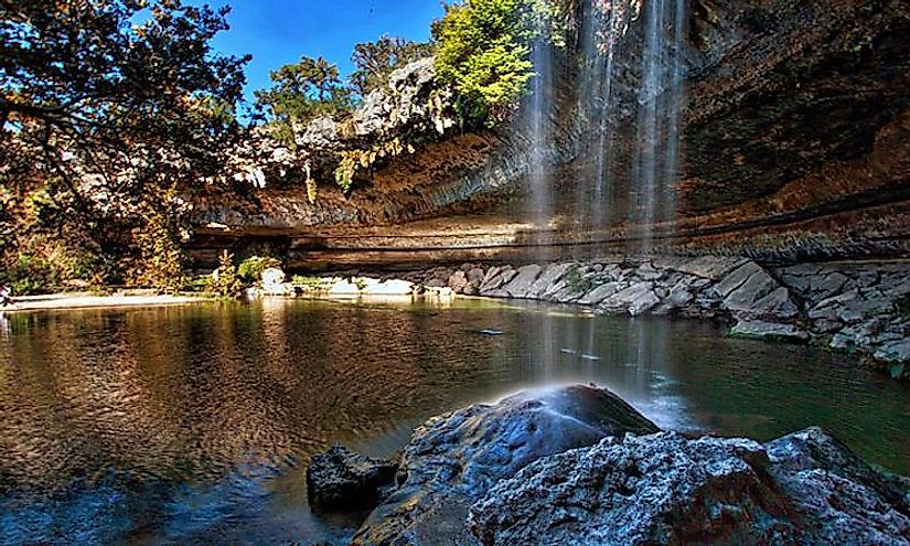 A waterfall flows freely into the Hamilton Pool, located in the Hamilton Pool Preserve about 30 miles from Austin, Texas.