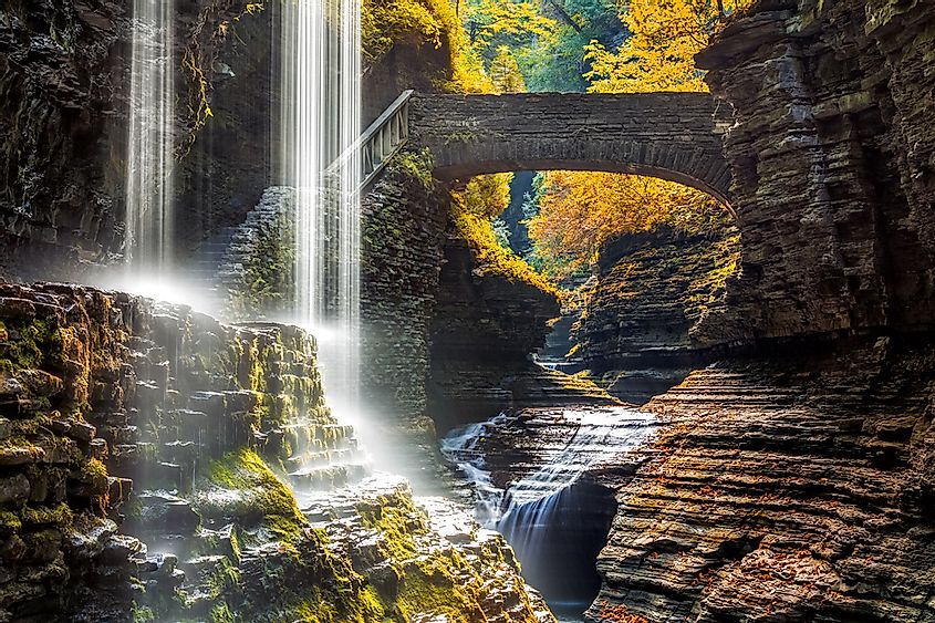 Rainbow Falls in Watkins Glen State Park. The steps leading up to Rainbow Bridge and the bridge itself are seen in the background.