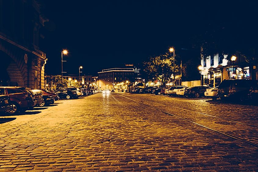 Cobblestone street in Fells Point at night, Baltimore, Maryland. Image credit: ESB Professional/Shutterstock.com