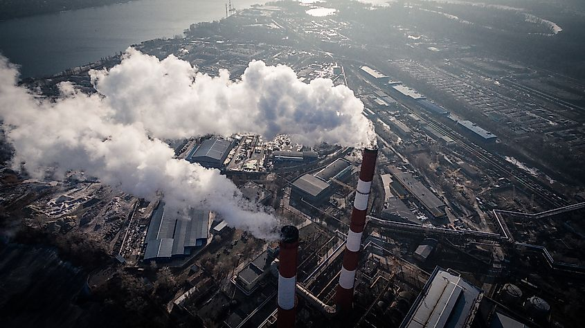 Air pollution caused by smoke coming out of two factory chimneys in the industrial zone of Kiev, Ukraine. Image credit: LALS STOCK/Shutterstock.com