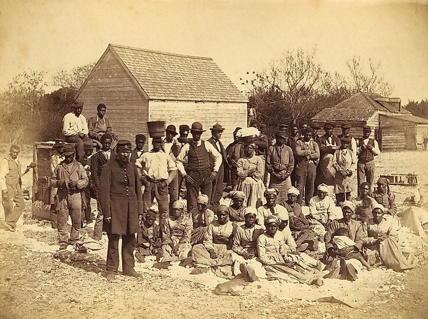 A Union soldier stands with African Americans on the plantation Thomas F. Drayton, Hilton Head Island, South Carolina, 1862. Photo by Henry P. Moore, May 1862.