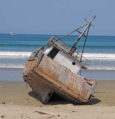 ecuador, manta, boat in the sand