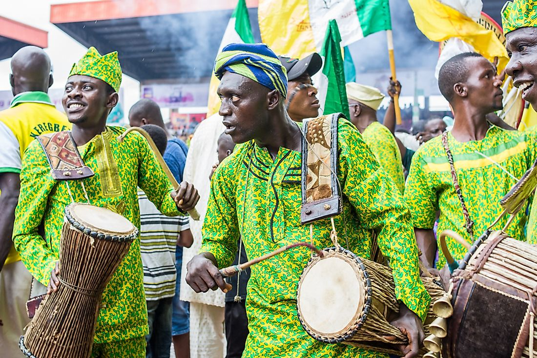 Drummers in traditional Yoruba clothing. Editorial credit: Ajibola Fasola / Shutterstock.com.