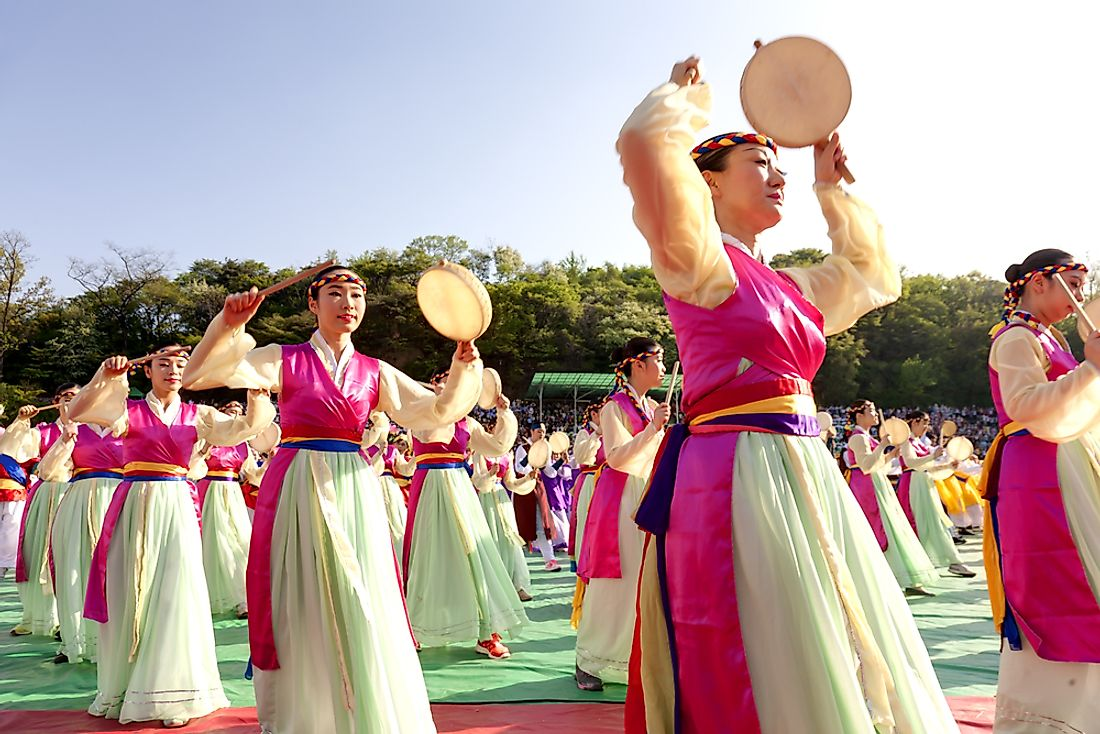 Performers at the Lotus Lantern Festival in Seoul, South Korea. The majority of South Korea's population is made up of ethnic Koreans. Editorial credit: qingqing / Shutterstock.com.