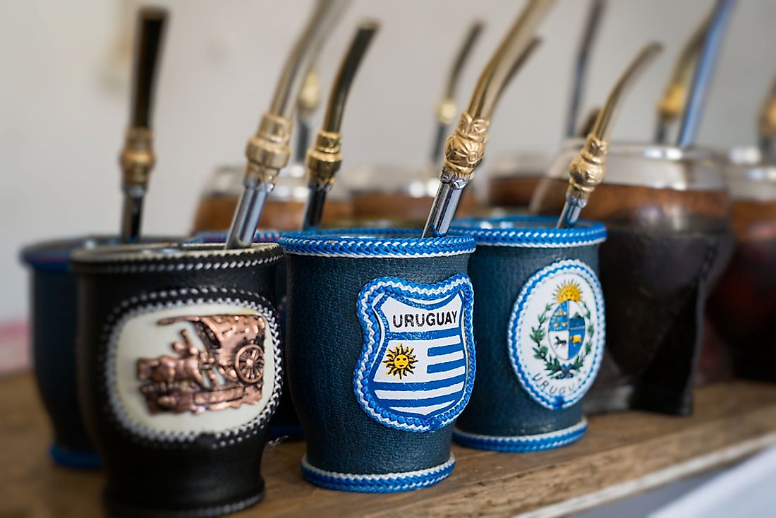 Cups used for drinking mate, a type of tea popular in Uruguay, are pictured here featuring the flag of Uruguay.