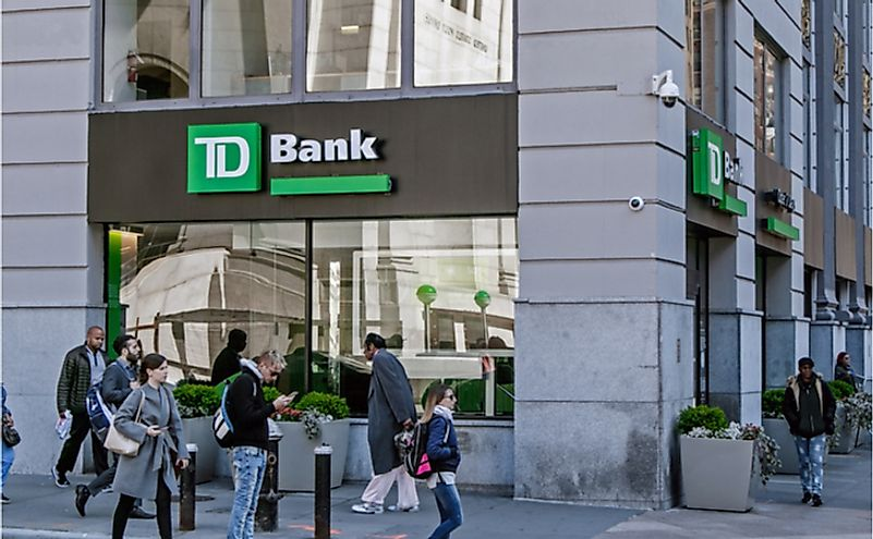 People walk by a TD Bank retail location in Manhattan. Editorial credit: Roman Tiraspolsky / Shutterstock.com