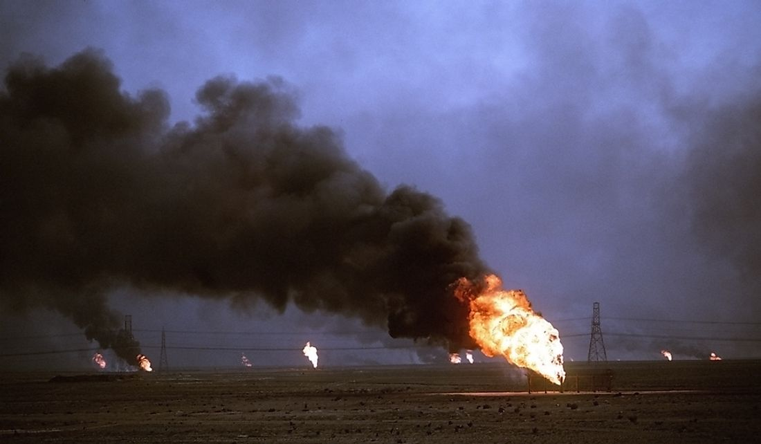 Kuwaiti oil wells set on fire by Iraqi forces.