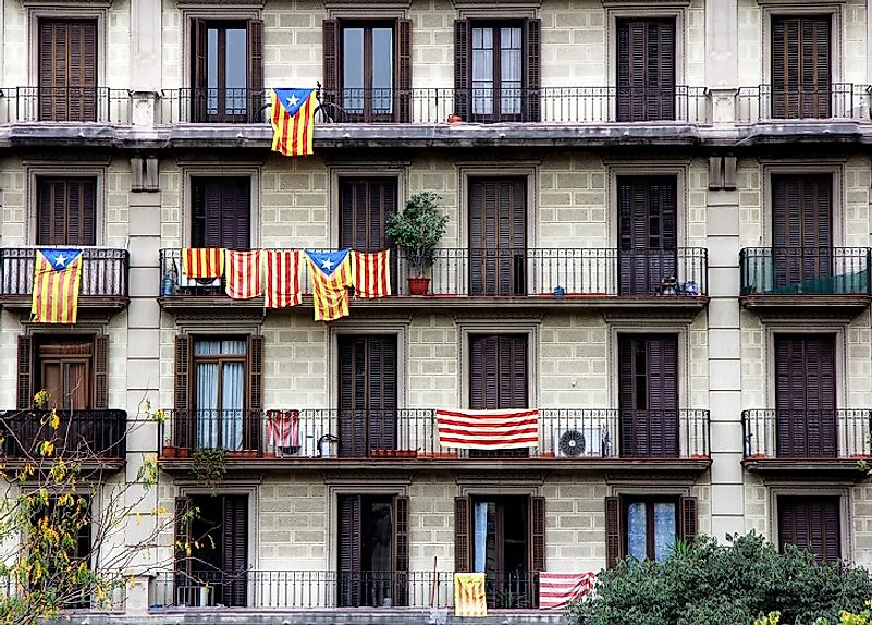 Catalan flags are flown outside houses in Barcelona by Catalonian Spaniards who desire a separate, autonomous Catalon state.