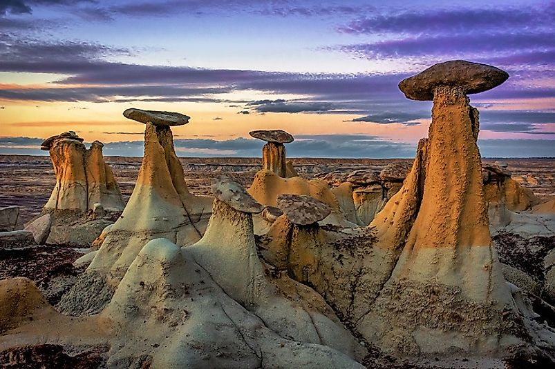 "The unique Ah-Shi-Sle-Pah ""hoodoos"" (foreground) amidst the badlands (background) of San Juan County, New Mexico, United States of America."