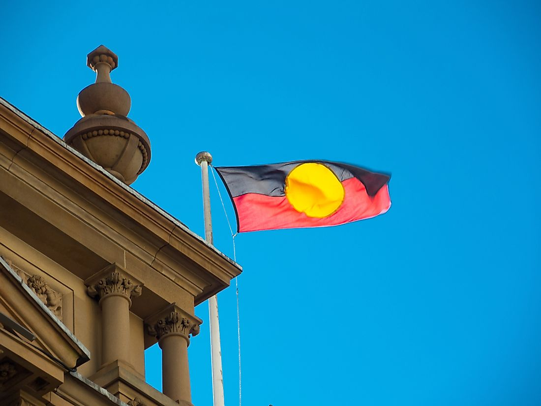 The Australian Aboriginal flag flying at Sydney City Hall. Editorial credit: ArliftAtoz2205 / Shutterstock.com.
