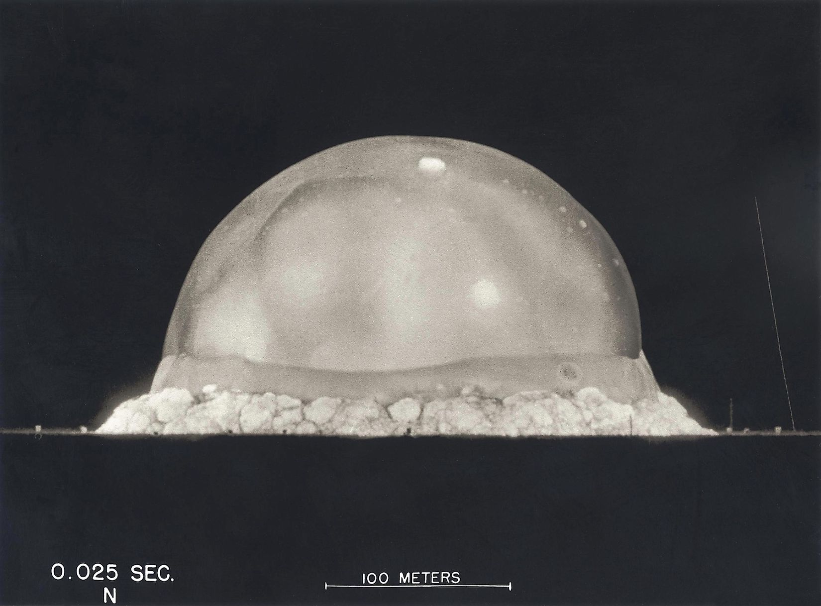 Photograph taken at .025 seconds after the Trinity initial detonation shows a plasma dome. Manhattan Project, World War 2. Alamogordo, New Mexico. Image credit: Everett Historical/Shutterstock.com