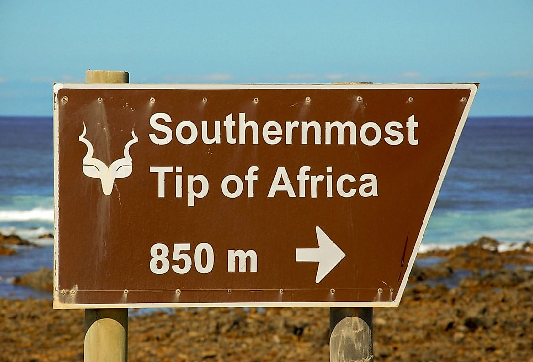 A sign directing visitors towards Cape Agulhas, the southernmost point in Africa.