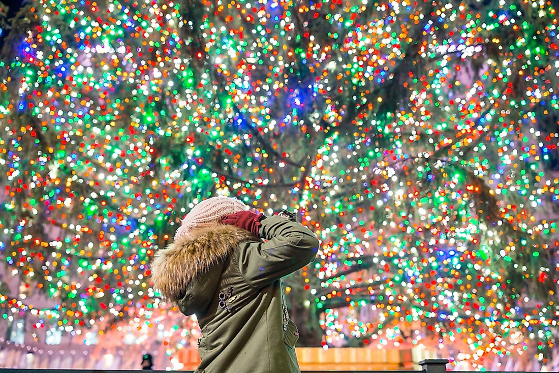 A girl marvels at the Rockefeller Center's Christmas tree.