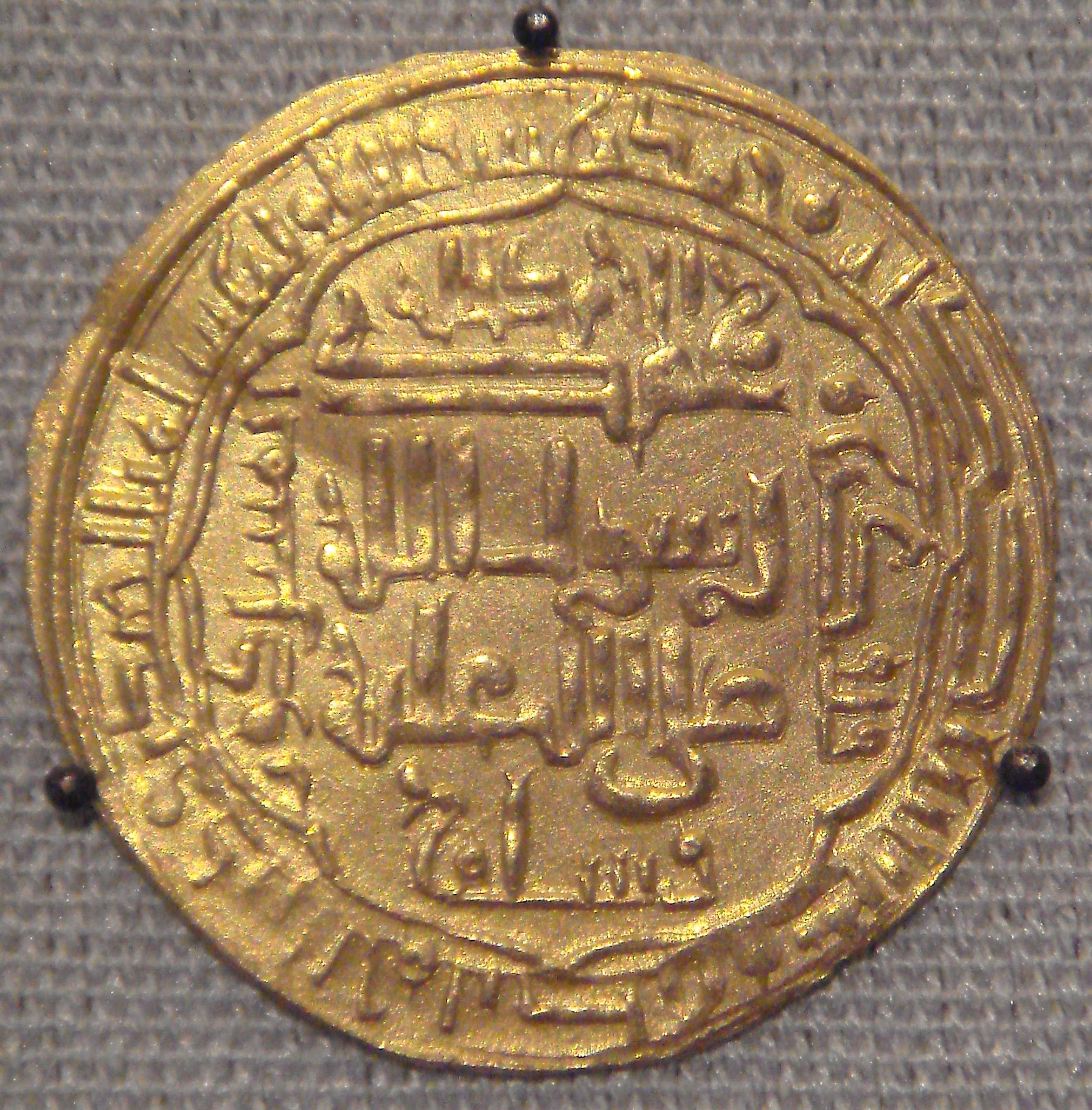 A gold coin belonging to the Abbasid Caliphate.