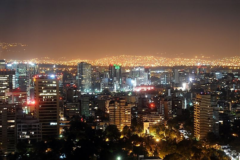 The modern metropolis of Mexico City and its millions of residents light up the skies each night as far as the eye can see.