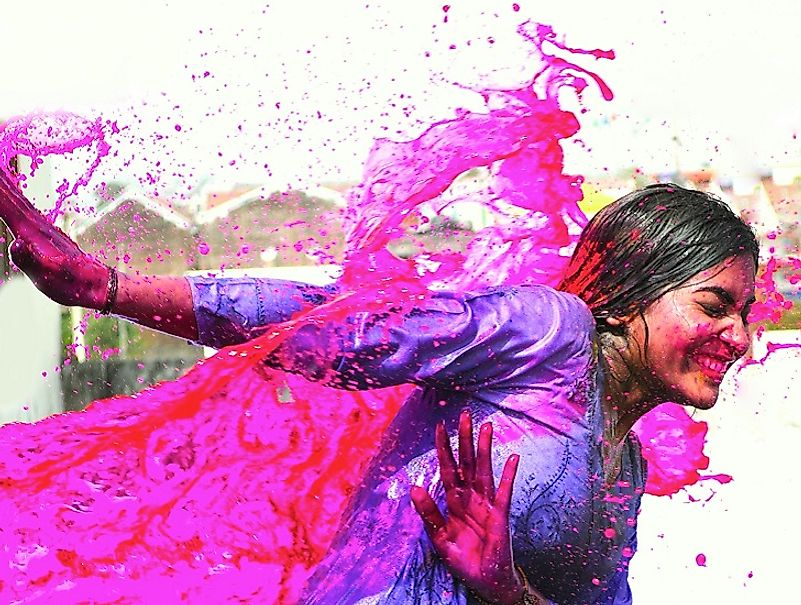 A woman splashed with colors during Holi.