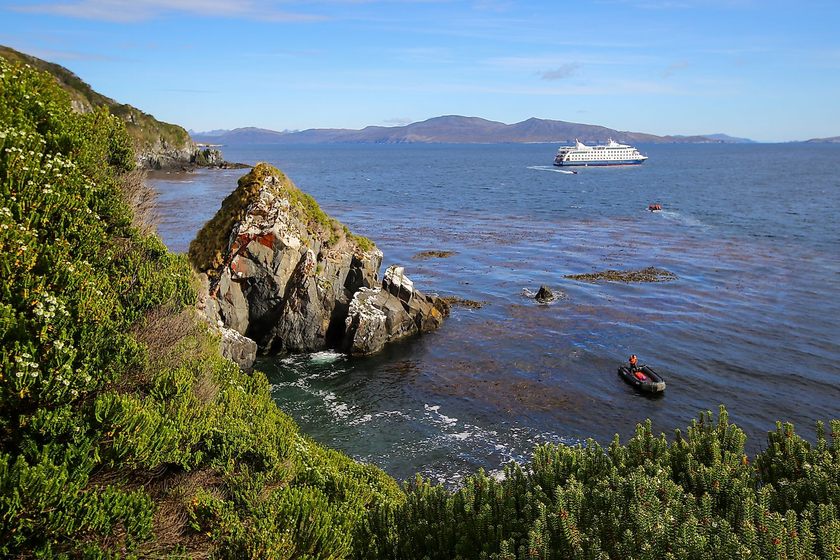 Cruise ship approaching the rocky coast of Cape Horn Island in Chile. Image credit: Alexandre G. ROSA/Shutterstock.com