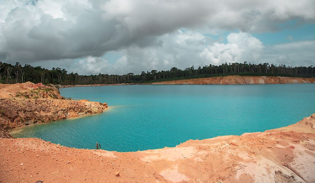 Blue lake in a former bauxite mining pit in Guana.