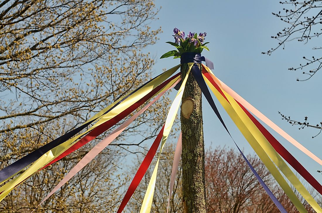 In the UK, May Day is traditionally celebrated by dancing around a maypole.