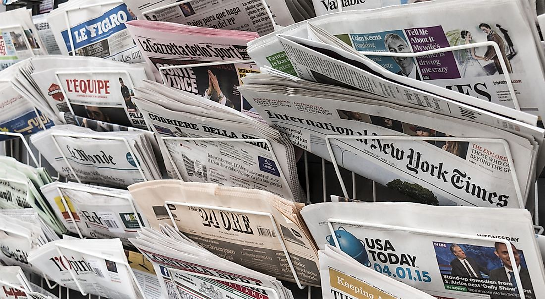 Newspapers being sold in various languages in New York City. Editorial credit: Lawrey / Shutterstock.com.