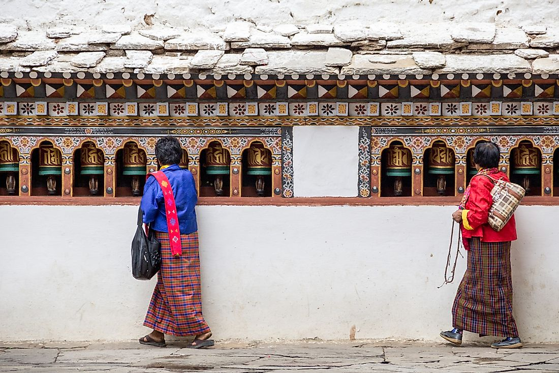 Bhutanese people at a temple.