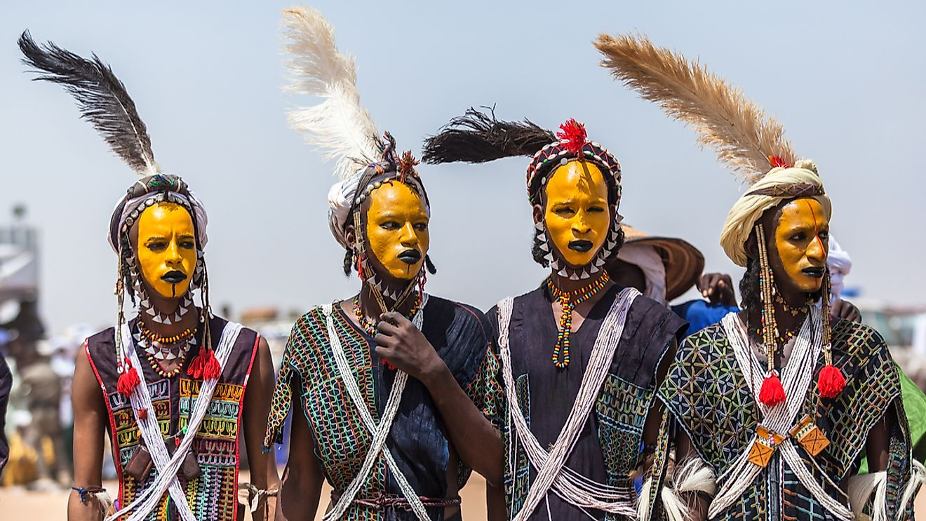 Gerewal Mbororo Wodaabe nomads have a yearly beauty competition colorful makeup in traditional clothes with the goal of seducing the women judges. Image credit: Katya Tsvetkova/Shutterstock