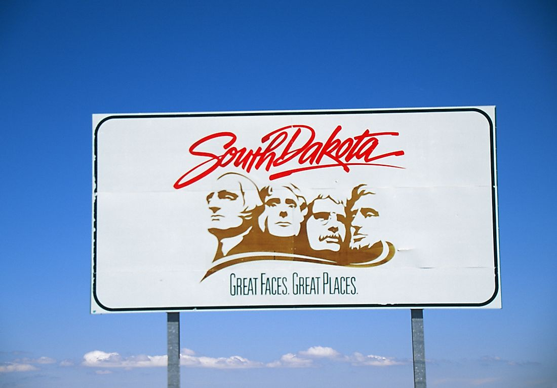 A sign welcoming visitors to South Dakota.