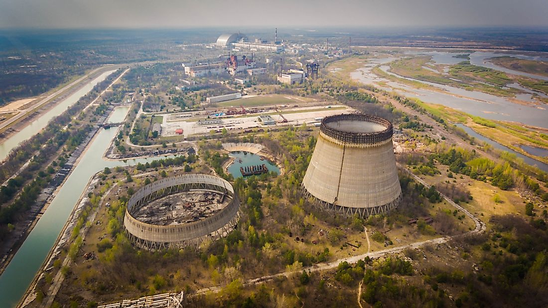 Aerial shot of Chernobyl nuclear reactors with straight canals around in spring