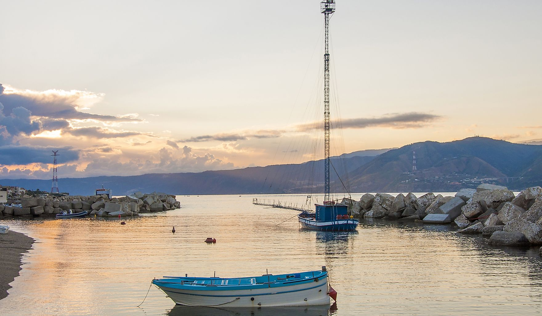 Feluca at dawn, the boats for swordfish hunting in the Strait of Messina, Sicily, Italy.