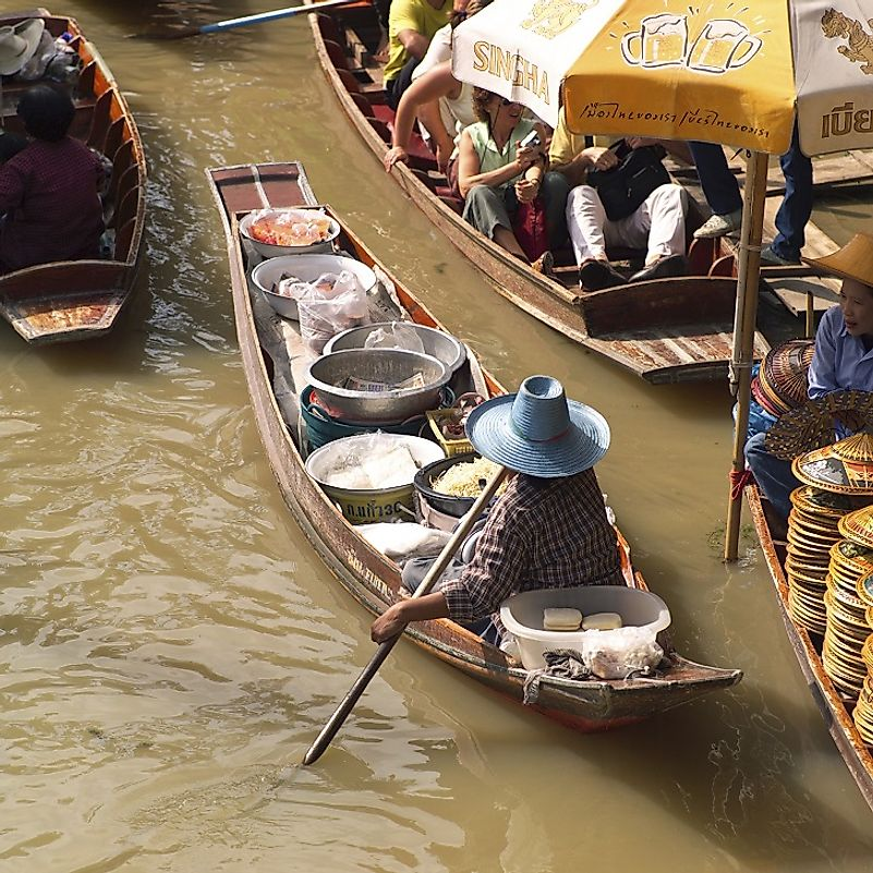 "This vendor sell his wares directly from his small boat in this ""floating market"" in Bangkok, Thailand."