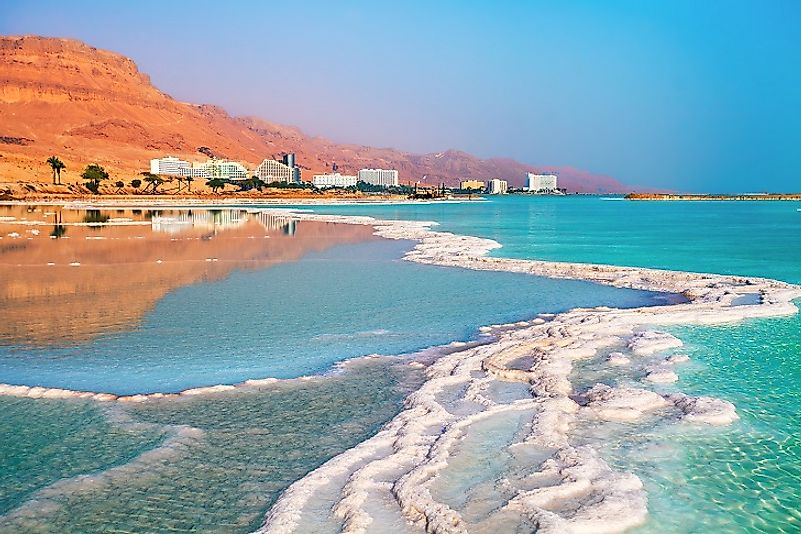 Salt accumulates along the shores of the Israeli resort district of Ein Bokek. Ein Bokek is on the coast of the Dead Sea, the lowest place on Earth.