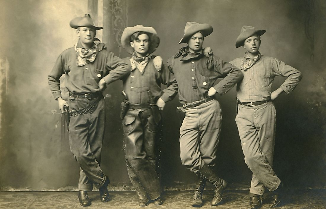 Men from the United States wearing cowboy hats at the turn of the 20th century.