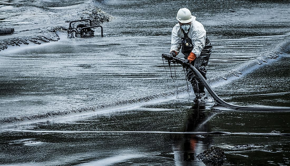 Cleaning up an oil spill in Thailand.