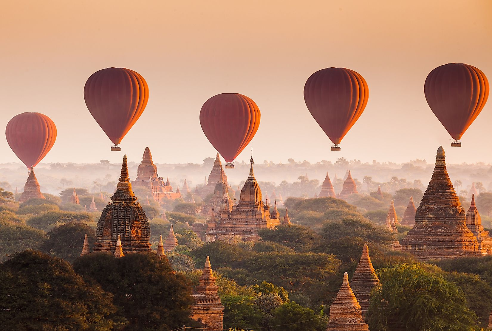 Hot air balloons over the plain of Bagan in Myanmar. Image credit: lkunl/Shutterstock.com